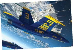 Capt. Brandon Cordill, left wingman of the U.S. Navy flight demonstration squadron, the Blue Angels, flies an F/A-18 Hornet over Baltimore during the Star Spangled Sailabration. Photo by Mass Communication Specialist 2nd Class Andrew Johnson/Released of the U.S. Navy