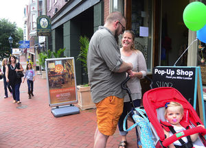 couple-with-baby-at-popup